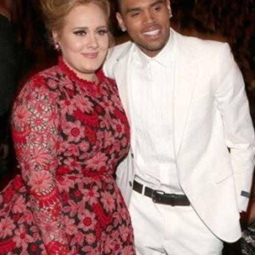 Adele rechaza riña con Chris Brown